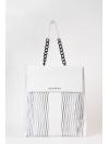 White laser-cut chain shoulder bag